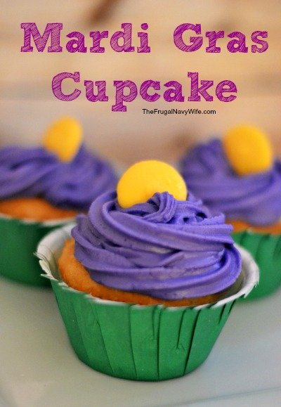 Mardi Gras cupcake with purple icing and a green cupcake wrapper.
