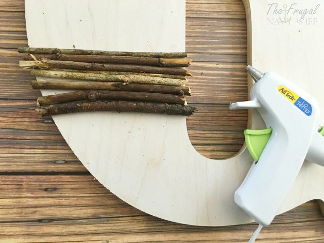 Looking for an easy DIY decor idea? This easy twig letter decor is perfect for not only home your decor but also for a rustic wedding too.