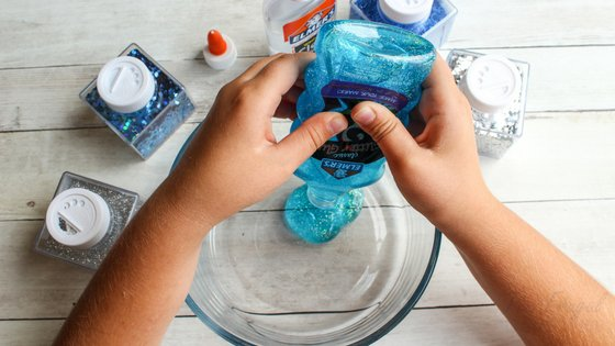 We made this Ocean Slime at the request of my son and they had a blast with it! Borax Free so it's totally safe for the kids. #slime #dolphins #oceanslime #homeschool #frugalnavywife | Slime Recipes | Homeschooling Activities | Dolphins Themed Activities | Ocean Themed Activities