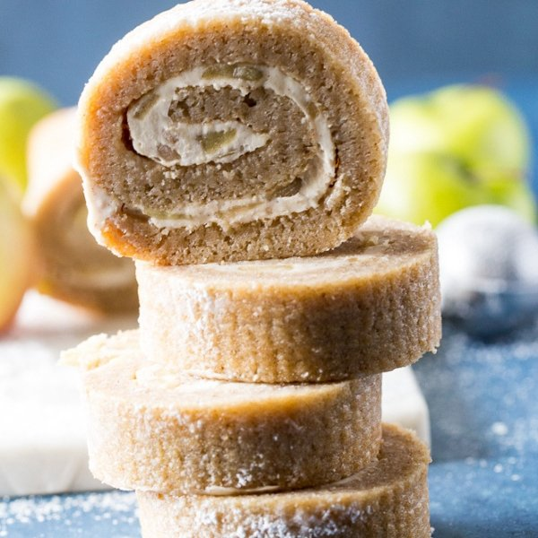 This Apple Cake Roll recipe is a fall crowd pleaser. Its the perfect apple dessert recipe for your holiday parties and easy to make. #applerecipe #applecake #desserts #frugalnavuwife | Apple Desserts | Fall Recipes | Apple Cake Recipes | Apple Roll Recipes | Apple Recipes