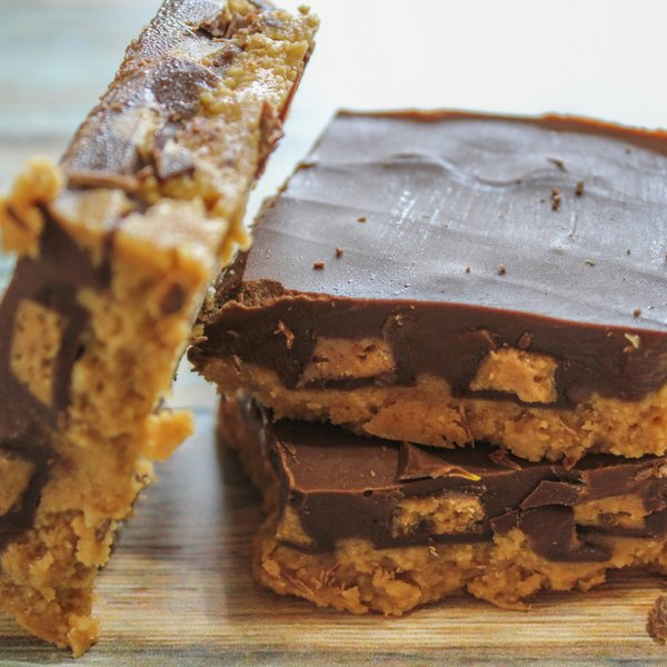 I love making these for my Christmas Candy Tins. My homemade Reese's peanut butter cups bars is a win-win for everyone! Make them this year. #reeses #frugalnavywife #desserts #recipe | Dessert Recipe | Homemade Reese's Cups | Reese's Bars Recipe |