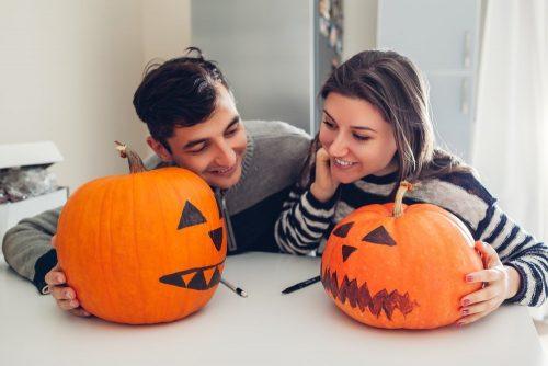 Caouple painting pumpkins