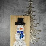 I'm on a button art kick and for winter I went with this Button Snowman Craft.I even got the kids to help they picked out buttons for me. Here's how to make it! #frugalnavywife #buttonart #snowman #winter #winterdecor #christmasdecor | Winter Decor | Snowman Decor | Button Art Ideas | Christmas Decor | Easy Crafts for kids | Easy DIY Ideas | Snowman Crafts for Kids
