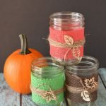 I love making my own DIY fall decorations. These burlap mason jar centerpieces are the newest addition to my decor and they double great as wedding decor! #frugalnavywife #burlapdecor #diydecorations #falldecor #weddingdecor #diycenterpieces #diy | DIY Fall Decor | DIY Wedding Decor | Decorations | Burlap Decor | Mason Jar Ideas | DIY Mason Jar Crafts