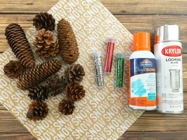 One of my favorite memories of winter and Christmas are making pine cone crafts and making pine cone Christmas decorations, like these DIY glitter pinecones