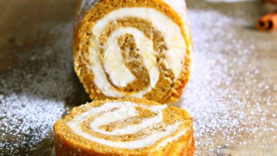 My pumpkin roll recipe is filled with cream cheese giving it an even richer taste! This is one of my favoritepumpkin recipes! #pumpkinrecipe #fallrecipe #pumpkinroll #autumn #frugalnavywife | Pumpkin Recipes | Fall Recipes | Dessert Recipes | Autumn Recipes