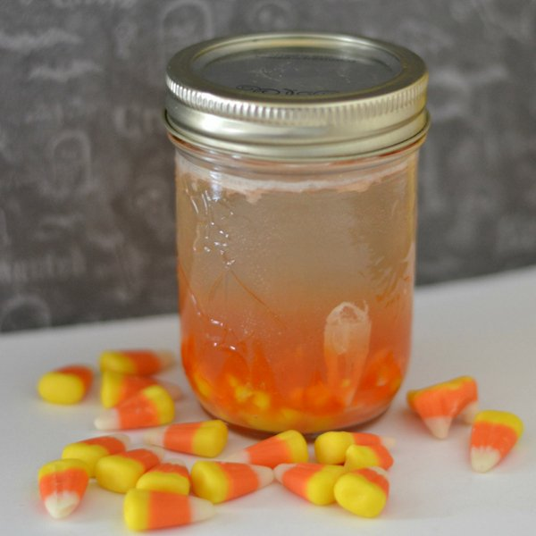 This candy corn infused vodka recipe seems to be quite popular this fall and it's so easy! Just 2 ingredients for the perfect Fall Party drink. #vodka #candycorn #cocktail #infusedvodka #frugalnavywife | Vodka Drinks | Candy Corn Recipes | Infused Vodka Drinks | Cocktails for Fall