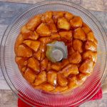 A simple customizable recipe for all occasions. This Paula Deen Monkey Bread is just the dessert recipe you need for your next gathering. #pauladeen #copycatrecipe #monkeybread #frugalnavywife | Monkey Bread Recipes | Paula Deen Recipes | Copycat Recipe | Dessert Recipe