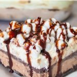 Hot Chocolate Lasagna Icebox Cake became an instant favorite in my home and it will yours too. It is so addicting, make it if you dare! #frugalnavywife #nobakecake #desserts #chocolatelasagna | Easy Dessert Recipe | Desserts | No-Bake Desserts | Chocolate Lasagna Recipes | Hot Chocolate Recipes |