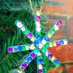 My kids love doing popsicle stick crafts. Here is our Popsicle Stick Snowflake Craft it was a great way to get the kids distracted during the holiday break!#frugalnavywife #popsiclestickcrafts #snowflakes #easycraftsforkids #diy   Easy Crafts for kids   Snowflake Crafts   DIY Crafts   Winter Crafts for kids   Popsicle Stick Craft Ideas