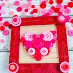 This Popsicle Stick Framewill make a great Valentine's Day gift for parents and grandparents. Change the colors on this craft to make it for any holiday. #frugalnavywife #valentinesday #popsiclestickcraft #buttoncrafts #craftsforkids #giftidea | Popsicle Stick Crafts | Button Crafts | Easy Crafts for Kids | Valentine's Day Crafts | Gift Ideas